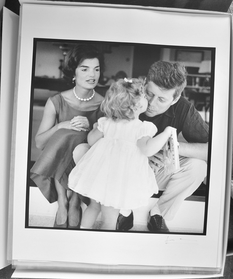 A candid shot of Jacqueline, Caroline, and John F. Kennedy prior to a formal photo shoot for their 1959 Christmas card. © The Estate of Jacques Lowe.