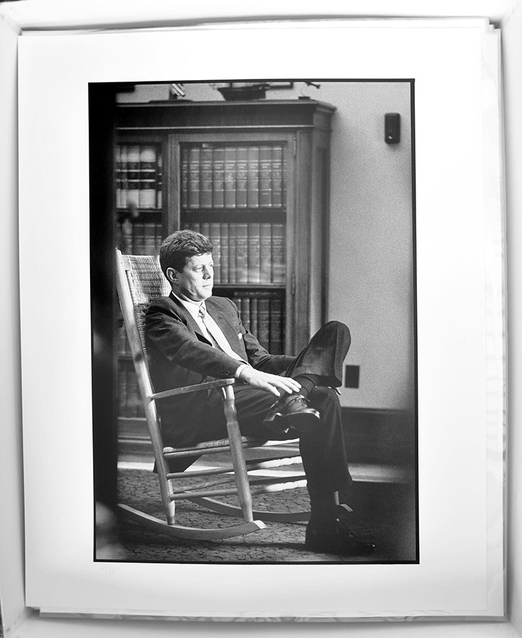 Sen. John F. Kennedy in his Capitol Hill office, photographed for the first time in his rocking chair (which he used to aid his back pain), 1958. © The Estate of Jacques Lowe.