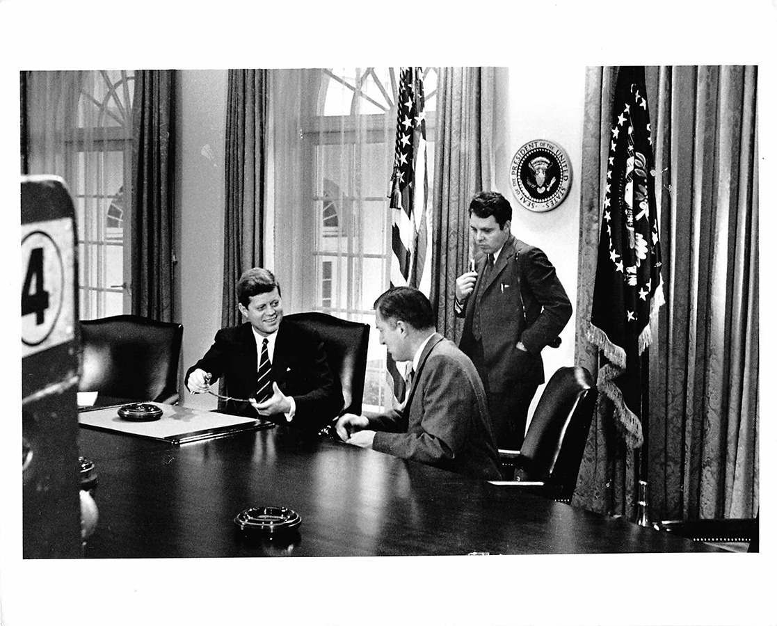Jacques Lowe observes President Kennedy's meeting in the Cabinet Room of the White House, ca. 1961. © The Estate of Jacques Lowe.