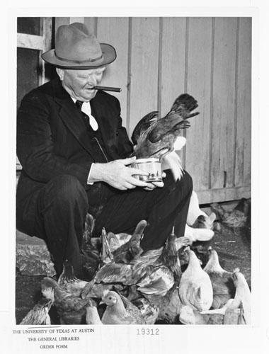 John Nance Garner feeding chickens. Ernest Othmer Thompson Papers. di_01407