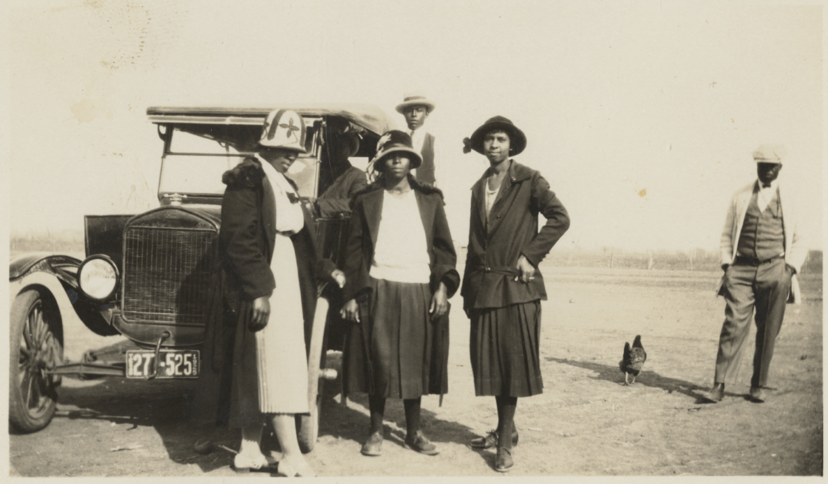 Five people posing in front of a Ford Model T. Rhone Family Papers. di_10766